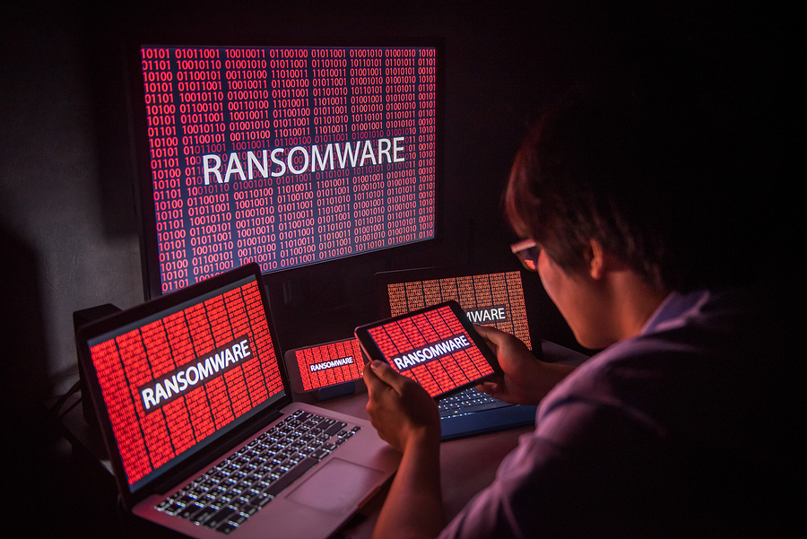 Young man frustrated over ransomware