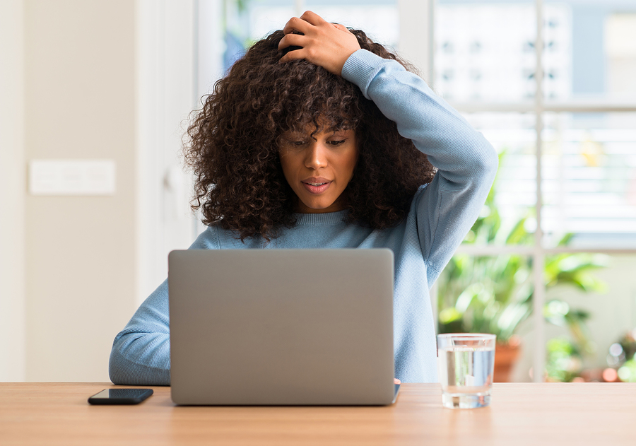 woman stressed over hacked laptop